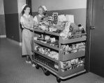 "St. Paul Hospital on Bryan Street, two members of the St. Paul Auxiliary push the ""Comfort..."