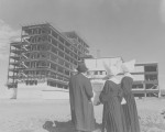 St. Paul Hospital on Harry Hines Blvd., under construction, two Daughers of Charity and a man...