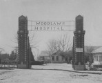 Woodlawn Hospital entry gates and buildings